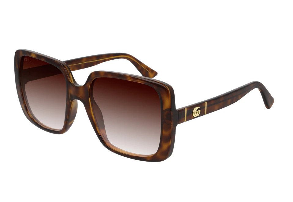 Gafas de Gucci 'oversize' en havana con detalle de la marca.