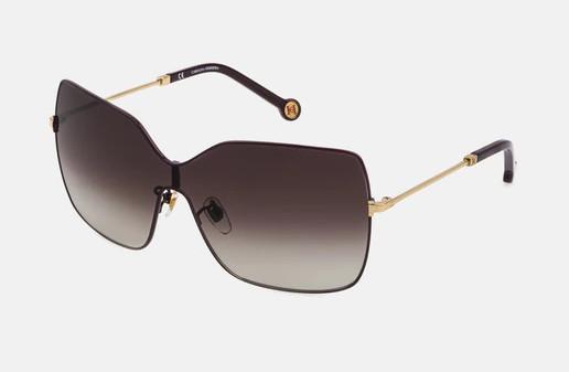 Gafas de Carolina Herrera de montura al aire en dorado.