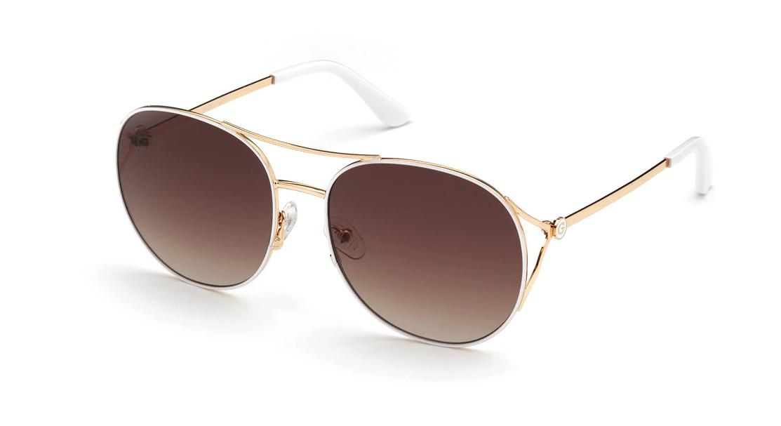 Gafas de Guess redondas de metal dorado con doble puente.